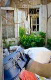 Ruins of house with old suitcase Royalty Free Stock Images