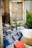 Ruins of house with old suitcase Royalty Free Stock Photography