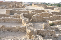 Ruins of houses with communal walls, Saar village. The excavated Saar village dates from the early Dilmun periods of 4000 years ago Stock Photo