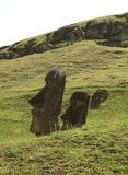 The ruins of huge Moai on the slope of Rano Raraku volcano, Rapa Nui national park on Easter Island, Chile royalty free stock photography