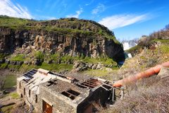 Ruins of a hydropower plant at White River State Park. Looking down at White River is a wild and scenic river canyon where an decaying hydropower plant sits Royalty Free Stock Images