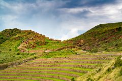 Ruins of Inca Citadel on the mountain at the Sacres Valley of Inca in Pisac. Peru stock images