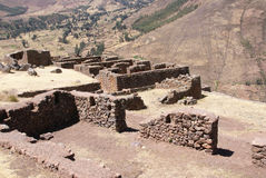Ruins of Inca village on small plateau. Of steep mountainside of Pisac, near   Cusco, Peru, South America Royalty Free Stock Photo