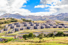 Ruins of Inkan fortress Saksaywaman with mountains in background Royalty Free Stock Image