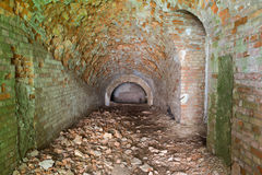 Ruins  inside  fort Tarakanovskiy. Casemates .  Dubno. Ukraine. Ruins  inside  fort Tarakanovskiy.  Destroyed building. Brick arch. Old stone tunnel leads to Stock Image