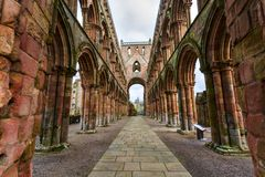 Ruins of Jedburgh Abbey in the Scottish Borders region in Scotland.  royalty free stock photography