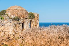 Ruins in Kastro, old metropolis of Skiathos. From distance its features resemble a face, 2018 royalty free stock image