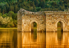 Ruins in the Lake. Sunset landscape of ruins, submerged in the lake stock images