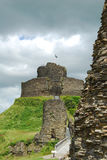 Ruins of Launceston Castle, Cornwall, threatening black clouds behind Stock Photography