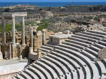 Ruins of Leptis Magna. Libya. Leptis Magna. Theatre - fragment of stage and auditorium (cavea). There are Market (with two tholoi), ruins of Old Forum and stock photos