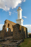 Ruins and lighthouse at Colonia del Sacramento. Lighthouse among colonial ruins at Colonia del Sacramento, Uruguay Stock Photos