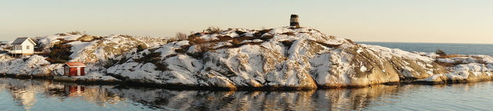 Ruins of the lighthouse on rocky island shelf Royalty Free Stock Image