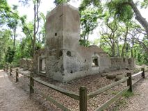 Ruins of a bygone era of plantations and slavery from the the 18th century. These are the ruins of the main house and slave quarters of a former plantation stock photography