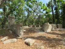 Ruins of a bygone era of plantations and slavery from the the 18th century. These are the ruins of the main house and slave quarters of a former plantation stock photo