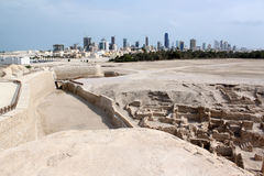 Ruins and Manama city Royalty Free Stock Photography