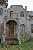 Ruins of the manor in the old village. Destroyed building of an. Old beautiful building in Central Europe. Season of the autumn royalty free stock image