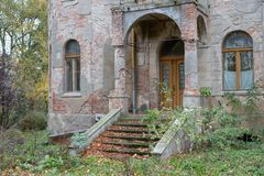 Ruins of the manor in the old village. Destroyed building of an. Old beautiful building in Central Europe. Season of the autumn stock photo