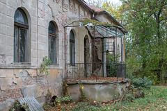 Ruins of the manor in the old village. Destroyed building of an. Old beautiful building in Central Europe. Season of the autumn stock images