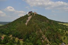 Ruins of the medieval castle on the top of the rock hill. The medieval castle on the top of the hill stock photography