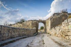 Ruins of medieval cave town Chufut-Kale, gate Orta-Kapu Stock Image
