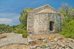 Ruins of medieval church with green trees around Royalty Free Stock Images
