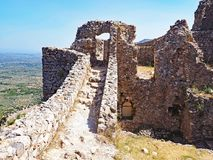Ruins of a medieval fortress at the ancient site of Mystras, Greece. Ruins of a medieval fortress located at the ancient hillside site of Mystras in Greece stock photo