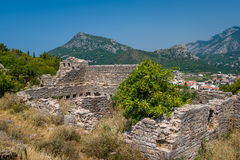 Ruins of medieval fortress with a mountain background Royalty Free Stock Images