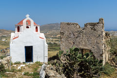The ruins of a medieval fortress and White church, Mykonos island, Greece Stock Photos