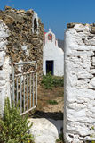 The ruins of a medieval fortress and White church, Mykonos island, Greece Stock Photo