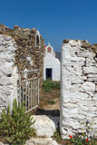The ruins of a medieval fortress and White church, Mykonos island, Greece Royalty Free Stock Image