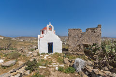 The ruins of a medieval fortress and White church, Mykonos island, Greece Stock Image