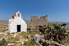 The ruins of a medieval fortress and White church, Mykonos island, Greece Stock Images