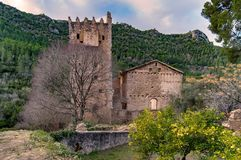 Ruins of Medieval Monastery of Jeronimos in Spain. In a valley with pine forests Stock Photography