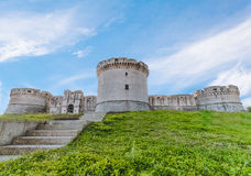 Ruins of medieval old tower of castle with stairs under blue sky in Matera Italy Stock Photo