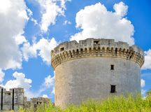 Ruins of medieval old tower of castle under blue sky with cloud Royalty Free Stock Photo