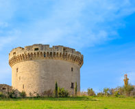 Ruins of medieval old tower of castle under blue sky with cloud Royalty Free Stock Photos