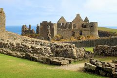 Ruins of medieval stone castle. The ruins of medieval Dunluce Castle on the coast in County Antrim in Northern Ireland stock photos