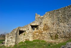 Ruins of a medieval stone house. Close-up. Wintertime. Blue sky with no clouds Royalty Free Stock Photo