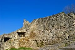Ruins of a medieval stone house. Close-up. Wintertime. Blue sky with no clouds Stock Images