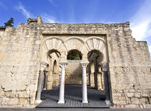 Ruins of Medina Azahara. Entrance to the Upper Basilica Hall at Medina Azahara medieval palace-city near Cordoba, Spain Royalty Free Stock Images