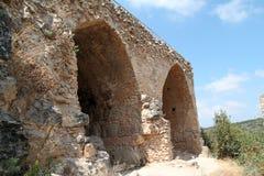 Ruins of Monfort Castle, Israel. Ruins of huge arcs at Monfort castle, crusader castle in western Galilee, Israel Stock Photo
