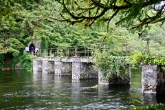 Bridge leading to the Monk`s fishing house at Cong Abbey, County Mayo, Ireland. Ruins of the Monk Fish House located in Cong, Ireland Royalty Free Stock Photography