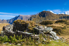 Ruins in the mountains. The ruins of a mountain hut in the Alps stock images