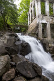 Ruins next to a waterfall in the  forest Royalty Free Stock Photos