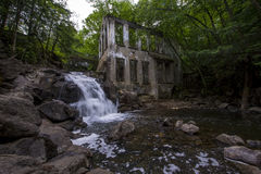 Ruins next to a waterfall in the  forest Stock Photo