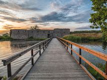 Free Ruins Of Ancient Castle With Bridge In Front At Sunset Time Stock Photo - 154271110