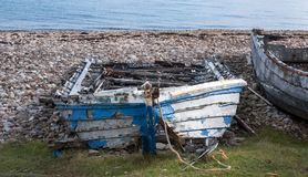 Free Ruins Of Small Boat On The Beach At Polbain, North Of Ullapool. In Background, View Of The Summer Isles, Scotland Stock Image - 125323761