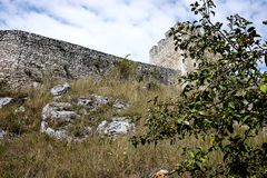 Ruins of old abandoned castle in slovakia. Ruins of old abandoned castle on the cliff with bricks and stone. architecture details in Slovakia royalty free stock photo