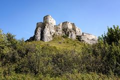 Ruins of old abandoned castle in slovakia. Ruins of old abandoned castle on the cliff with bricks and stone. architecture details in Slovakia stock photography