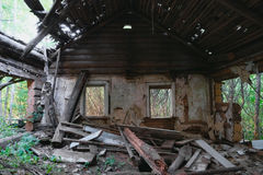 Ruins of old abandoned wooden house Stock Image